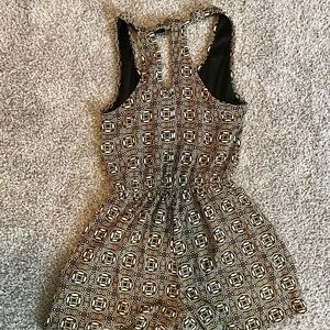 Dark blue and gold patterned romper.